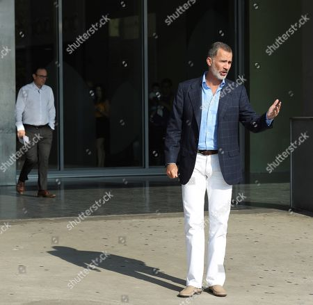 Spain's King Felipe VI talks to members of the press upon arrival at Hospital Quiron Salud Madrid for visiting his father emeritus king Juan Carlos I (unseen), in the town of Pozuelo de Alarcon, outside Madrid, Spain, 28 August 2019. The monarch recovers in the hospital from a triple bypass surgery last 24 August.