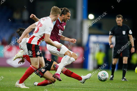 Jay Rodriguez of Burnley is tackled by George Dobson of Sunderland during the EFL Cup match between Burnley and Sunderland at Turf Moor, Burnley