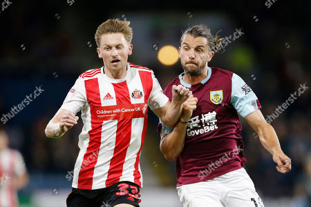 Denver Hume of Sunderland and Jay Rodriguez of Burnley during the EFL Cup match between Burnley and Sunderland at Turf Moor, Burnley