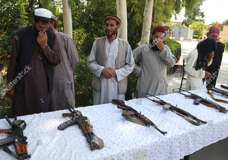 Former Taliban and IS militants surrender their weapons during a reconciliation ceremony in Jalalabad, Afghanistan, 28 August 2019. A group of 20 former Taliban and IS members on 28 August, laid down their arms in Jalalabad and joined the peace process. Under an amnesty launched by former President Hamid Karzai and backed by the US in November 2004, hundreds of anti-government militants have surrendered to the government.