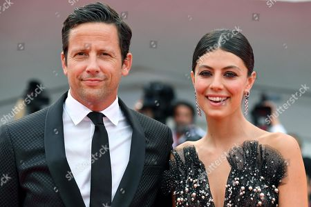 Alessandra Mastronardi (R) and her fiance Ross McCall arrive for the opening ceremony and screening of 'La Verite'' at the 76th annual Venice International Film Festival, in Venice, Italy, 28 August 2018. The festival runs from 28 August to 07 September.