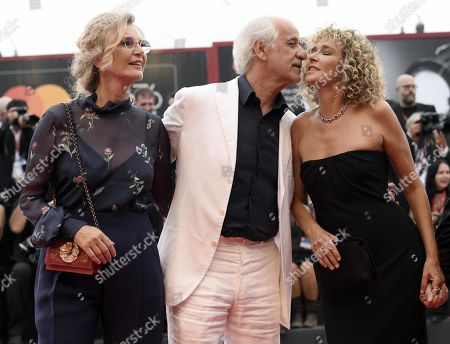 Toni Servillo (C) with his wife Manuela Lamanna (L) and Italian actress Valeria Golino (R), arrive for the opening ceremony and screening of 'La Verite'' at the 76th annual Venice International Film Festival, in Venice, Italy, 28 August 2019. The festival runs from 28 August to 07 September.