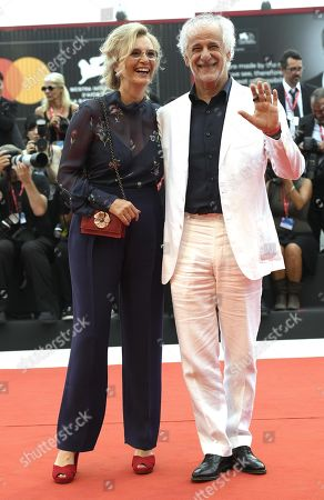 Toni Servillo (R) with his wife Manuela Lamanna, arrives for the opening ceremony and screening of 'La Verite'' at the 76th annual Venice International Film Festival, in Venice, Italy, 28 August 2019. The festival runs from 28 August to 07 September.