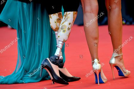 Jo Squillo (R), Giusy Versace (C) and a guest arrive for the opening ceremony and screening of 'La Verite'' at the 76th annual Venice International Film Festival, in Venice, Italy, 28 August 2018. The festival runs from 28 August to 07 September.