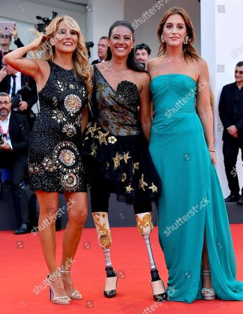 Jo Squillo (L), Giusy Versace (C) and a guest arrive for the opening ceremony and screening of 'La Verite'' at the 76th annual Venice International Film Festival, in Venice, Italy, 28 August 2018. The festival runs from 28 August to 07 September.