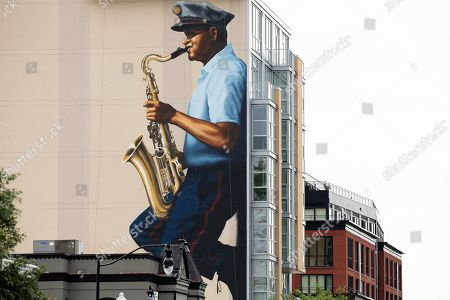 A new 70-foot-tall mural depicts late US jazz musician Buck Hill, in Washington, DC, USA, 28 August 2019. A native of Washington, DC, Buck Hill was a mail carrier with the US Postal Service for forty years and performed in jazz clubs in the city's U Street Corridor during the 1940s. Nicknamed 'the Wailin' Mailman', Hill recorded with jazz legends Dizzy Gillespie and Miles Davis.