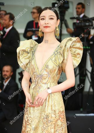 Ni Ni poses for photographers upon arrival at the premiere of the film 'The Truth' and the opening gala of the 76th edition of the Venice Film Festival, Venice, Italy