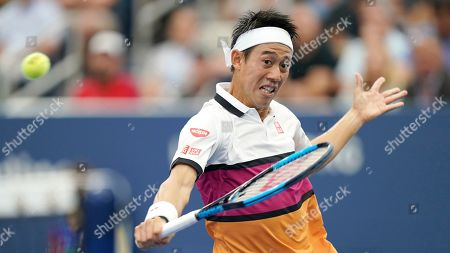 Kei Nishikori, of Japan, returns a shot to Bradley Klahn, of the United States, during the second round of the US Open tennis championships, in New York