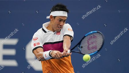 Stock Image of Kei Nishikori, of Japan, returns a shot to Bradley Klahn, of the United States, during the second round of the US Open tennis tournament, in New York