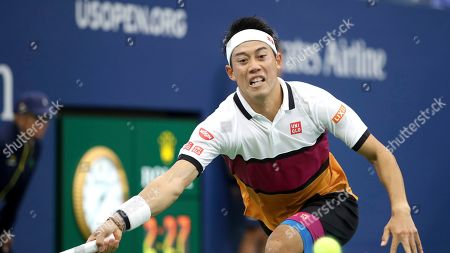 Stock Picture of Kei Nishikori, of Japan, returns a shot to Bradley Klahn, of the United States, during the second round of the US Open tennis championships, in New York