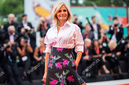 Isabella Ferrari poses for photographers upon arrival at the premiere of the film 'The Truth' and the opening gala at the 76th edition of the Venice Film Festival, Venice, Italy