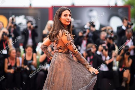 Giulia Valentina poses for photographers upon arrival at the premiere of the film 'The Truth' and the opening gala at the 76th edition of the Venice Film Festival, Venice, Italy