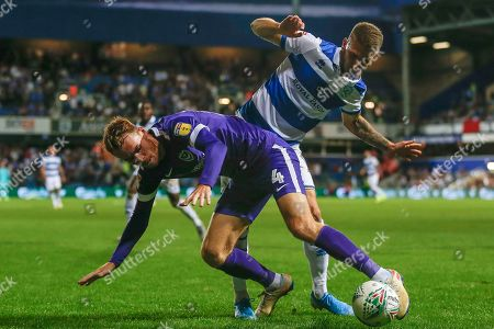 Portsmouth midfielder Tom Naylor (4) battles with Queens Park Rangers forward Jan Mlakar (16) during the EFL Cup match between Queens Park Rangers and Portsmouth at the Kiyan Prince Foundation Stadium, London