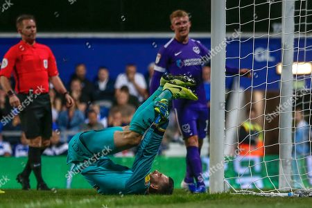 Queens Park Rangers goalkeeper Liam Kelly (32) lies on the floor defeated by the penalty of Portsmouth forward John Marquis (10) (not in picture) during the EFL Cup match between Queens Park Rangers and Portsmouth at the Kiyan Prince Foundation Stadium, London