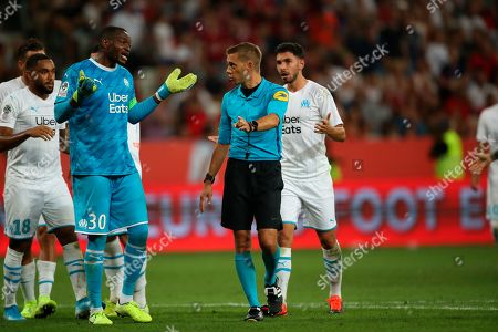 ONE. Marseille's goalkeeper Steve Mandanda disputes a penalty call during the French League One soccer match between Nice and Marseille at the Allianz Riviera stadium in Nice, southern France