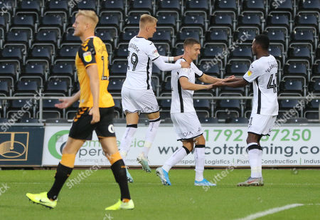 Stock Picture of Kristoffer Peterson of Swansea City, centre, celebrates with Sam Surridge of Swansea City and Jordan Garrick of Swansea City after scoring goal in the opening minute of the match