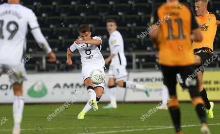 Tom Carroll of Swansea City fires a shot at goal
