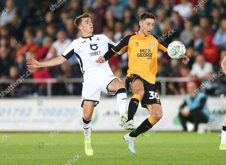 Tom Carroll of Swansea City and \c30\ compete for the ball