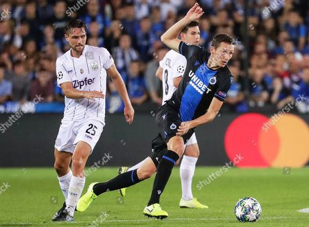 Hans Vanaken (R) of Club Brugge in action against James Holland (L) of LASK during the UEFA Champions League playoff, second leg soccer match between Club Brugge and LASK in Bruges, Belgium, 28 August 2019.