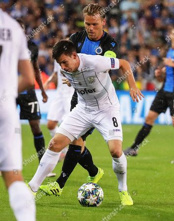 Ruud Vormer (back) of Club Brugge in action against Peter Michorl (front) of LASK during the UEFA Champions League playoff, second leg soccer match between Club Brugge and LASK in Bruges, Belgium, 28 August 2019.