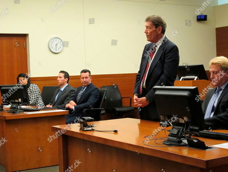 Franklin County Prosecutor Ron O'Brien speaks during a court hearing for defendant William Husel, second from left, as defense attorneys Diane Menashe and Jose Baez and assistant prosecutor James Lowe listen, in Columbus, Ohio. Husel is accused of ordering excessive painkiller doses for hospital patients and has pleaded not guilty to 25 counts of murder