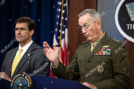 Joseph Dunford, Mark Esper. Joint Chiefs Chairman Gen. Joseph Dunford with Secretary of Defense Mark Esper speaks to reporters during a briefing at the Pentagon