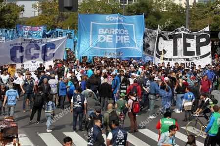 People participate in a protest against the economic crisis in Buenos Aires, Argentina, 28 August 2019. Protest against the situation of 'catastrophe' of the country took play on 28 August following the primary elections on 11 August that caused the dollar growth on 29,87 percent in front of Argentinian peso. Current Argentinian President Mauricio Macri lost the primary vote held on 11 August to Alberto Fernandez and his running mate, former President Cristina Kirchner.