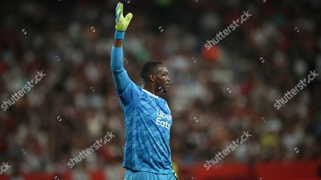 Marseille's goalkeeper Steve Mandanda gestures during the French League One soccer match between Nice and Marseille at the Allianz Riviera stadium in Nice, southern France
