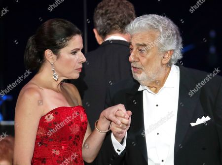 Stock Image of Opera star Placido Domingo holds the hand of Ana Maria Martinez at the end of a concert in Szeged, Hungary, . Domingo continued his calendar of European engagements unabated despite allegations of sexual harassment, appearing Wednesday at a concert in southern Hungary to inaugurate a sports complex for a local Catholic diocese