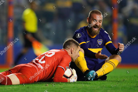Daniele De Rossi of Argentina's Boca Juniors, right, reacts as goalkeeper Erik Viveros of Ecuador's Liga Deportiva Universitaria catches the ball during a quarter final second leg Copa Libertadores soccer match in Buenos Aires, Argentina,. The game ended in a 0-0 tie and Argentina's Boca Juniors qualified to semi final series on a 3-0 aggregate score