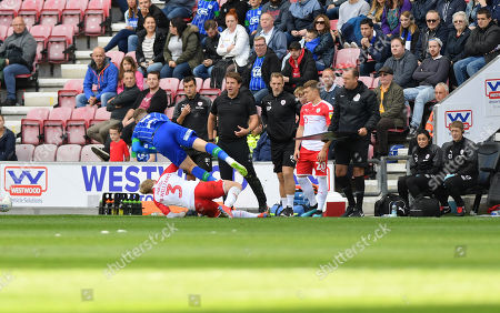 Barnsley's Ben Williams is sent off for this challenge on Wigan's Lee Evans.