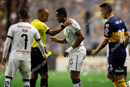 Stock Image of Referee Wilton Sampaio of Brazil, second from left, talks with Antonio Valencia of Ecuador's Liga Deportiva Universitaria after showing a yellow card during a quarter final second leg Copa Libertadores soccer match against Argentina's Boca Juniors in Buenos Aires, Argentina