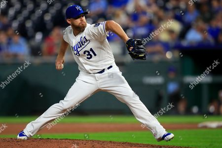Kansas City Royals relief pitcher Ian Kennedy delivers to an Oakland Athletics batter during the ninth inning of a baseball game at Kauffman Stadium in Kansas City, Mo., . The Royals won 6-4
