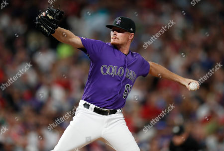 Stock Photo of Colorado Rockies relief pitcher Sam Howard works against the Boston Red Sox during the fifth inning of a baseball game, in Denver