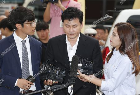 Yang Hyun-suk (C), former chief producer and founder of YG Entertainment, speaks to the media upon his arrival at the Seoul Metropolitan Police Agency in Seoul, South Korea, 29 August 2019. Yang and Seungri, a former member of boy band BIGBANG, will be investigated by police on charges of illegal gambling abroad. They are suspected of gambling up to tens of millions of won at a time at casinos, including the MGM Hotel and Casino in Las Vegas. Gambling is illegal in Korea.