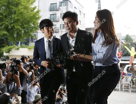 Yang Hyun-suk (C), former chief producer and founder of YG Entertainment, arrives at the Seoul Metropolitan Police Agency in Seoul, South Korea, 29 August 2019. Yang and Seungri, a former member of boy band BIGBANG, will be investigated by police on charges of illegal gambling abroad. They are suspected of gambling up to tens of millions of won at a time at casinos, including the MGM Hotel and Casino in Las Vegas. Gambling is illegal in Korea.