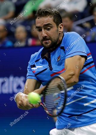 Marin Cilic, of Croatia, returns a shot to Cedrik-Marcel Stebe, of Germany, during the second round of the U.S. Open tennis tournament, in New York