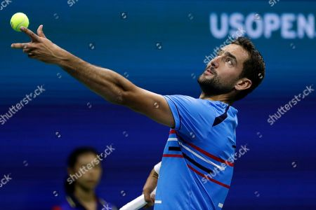 Marin Cilic, of Croatia, serves to Cedrik-Marcel Stebe, of Germany, during the second round of the U.S. Open tennis tournament, in New York