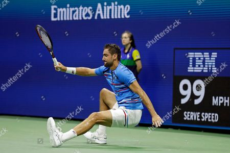 Marin Cilic, of Croatia, falls to the court during a match against Cedrik-Marcel Stebe, of Germany, during the second round of the U.S. Open tennis tournament, in New York