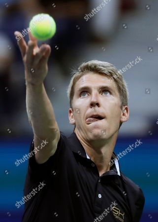 Cedrik-Marcel Stebe, of Germany, tosses the ball for a serve to Marin Cilic, of Croatia, during the second round of the U.S. Open tennis tournament, in New York
