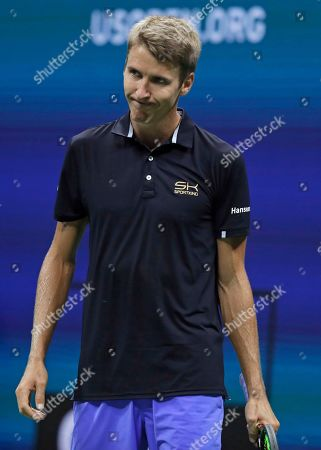 Cedrik-Marcel Stebe, of Germany, reacts after losing a point to Marin Cilic, of Croatia, during the second round of the U.S. Open tennis tournament, in New York