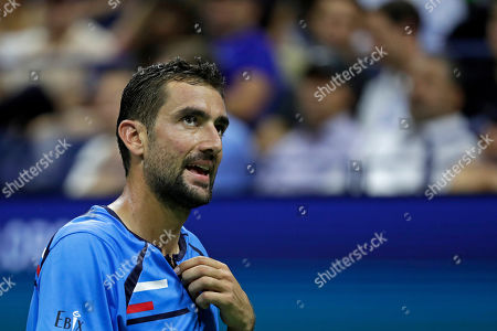 Marin Cilic, of Croatia, reacts during a match against Cedrik-Marcel Stebe, of Germany, in the second round of the U.S. Open tennis tournament, in New York