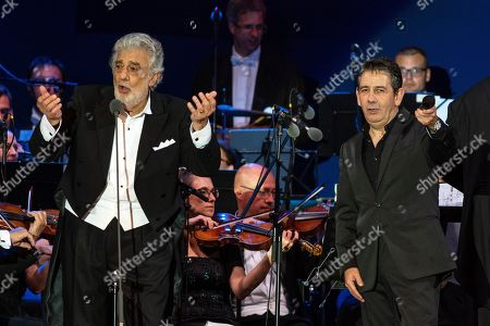Spanish opera singer Placido Domingo (L) performs with his son his son, Placido Domingo Jr. (R) as part of the inauguratation ceremony of the Szent Gellert Forum youth sports complex of the local Catholic diocese in Szeged, southern Hungary, 28 August 2019 (issued 29 August).