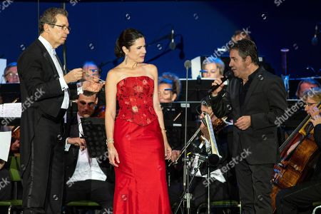 Conductor Euguene Kohn, Spanish opera singer Ana Maria Martinez and the son of Spanish opera star Placido Domingo share the stage during Domingo's concert as part of the inauguratation ceremony of the Szent Gellert Forum youth sports complex of the local Catholic diocese in Szeged, southern Hungary, 28 August 2019 (issued 29 August).