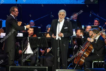 Stock Photo of Spanish opera singer Placido Domingo (C) performs with conductor Eugene Kohn (L) as part of the inauguratation ceremony of the Szent Gellert Forum youth sports complex of the local Catholic diocese in Szeged, southern Hungary, 28 August 2019 (issued 29 August).