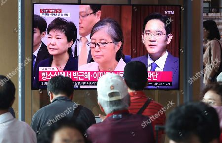 Park Geun-hye, Choi Soon-sil, Lee Jae Yong. People watch a live TV screen showing a former South Korean President Park Geun-hye, left, her longtime confidante, Choi Soon-sil, and Samsung Group heir Lee Jae Yong, right, during a news program at the Seoul Railway Station in Seoul, South Korea, . South Korea's top court on Thursday sent back Park's corruption case to a lower court for separate trials for her previously convicted charges, a ruling that could increase her already-lengthy prison term