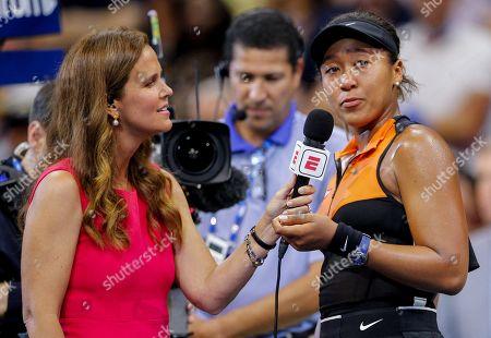 Mary Joe Fernandez interviews an emotional Naomi Osaka of Japan following her straight set win over Cori Gauff of USA