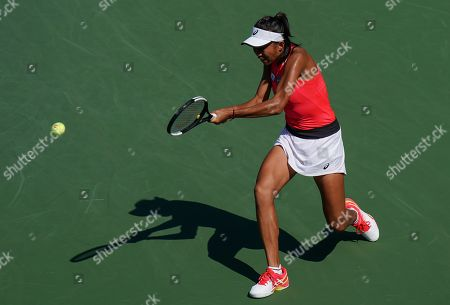 Zhang Shuai of China in action in the third round