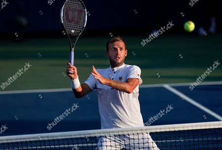 Dan Evans of Great Britain in action at the net during play in the Men's Doubles