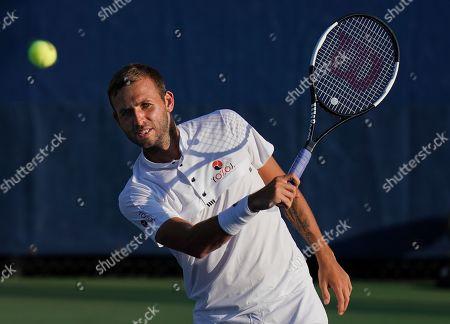 Dan Evans of Great Britain in action in the Men's Doubles